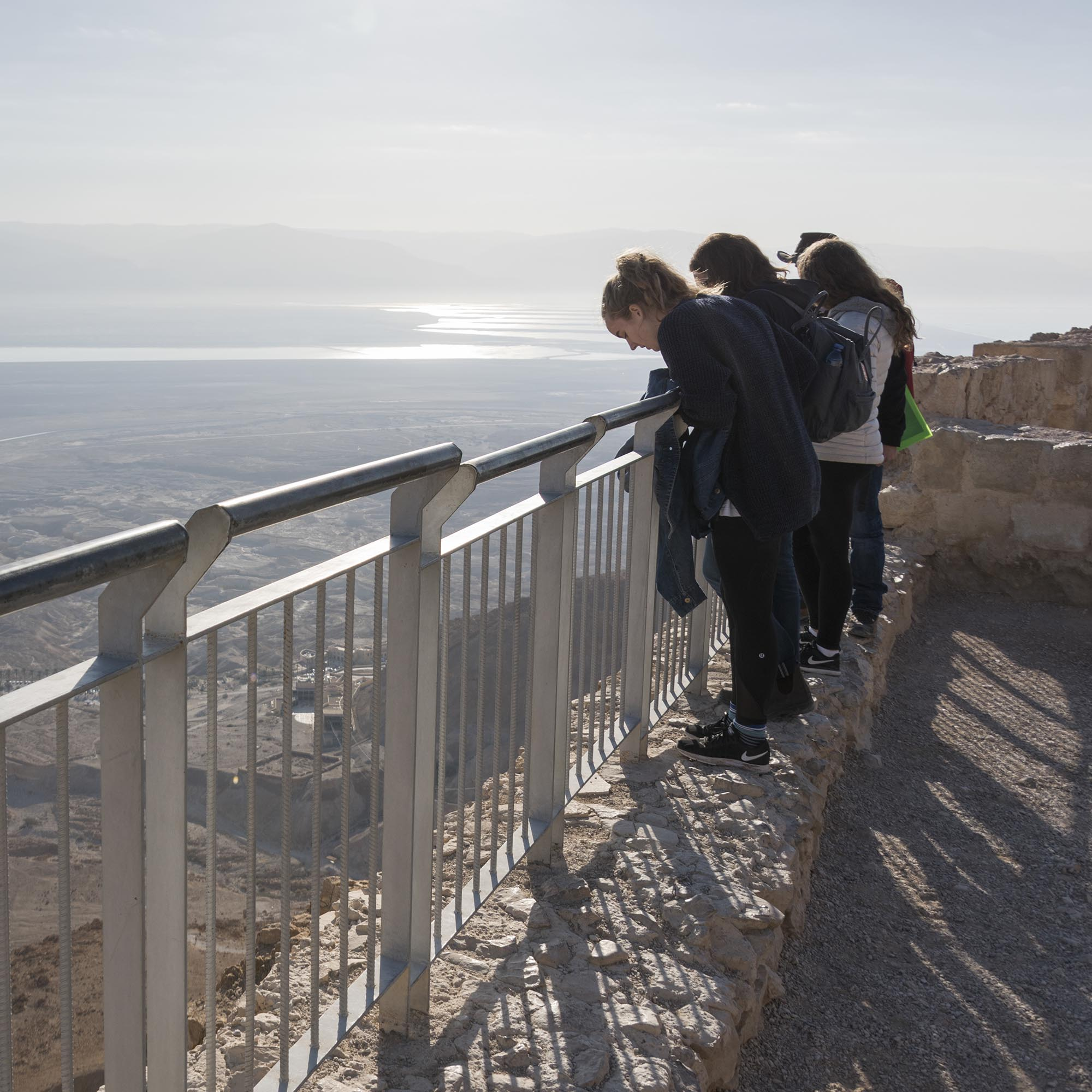Tourists standing on terrace of the fort of Masada