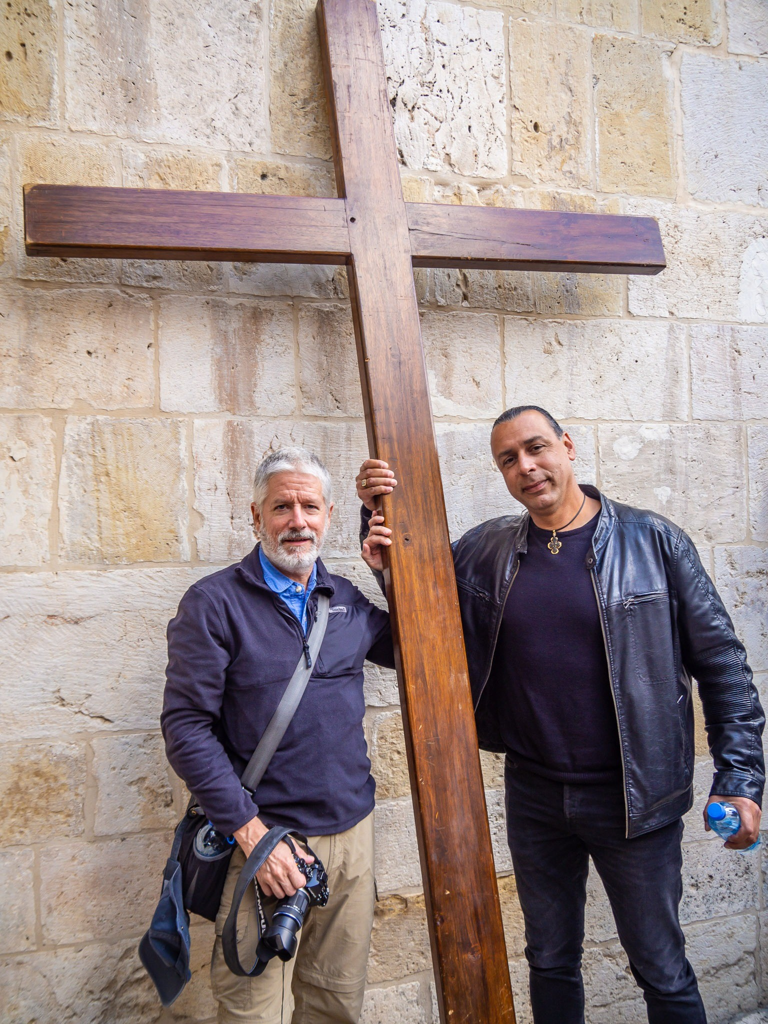 Holding a cross